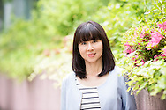 Portrait of a smartly dressed mid adult Japanese woman. Asian female in her 30's looking to camera