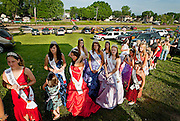 Moments before the coronation, more than a dozen beauty queens from in-and-around Southeast Ohio wait for their turn to address a small crowd of Chauncey residents. Queens and runners-up of every beauty pageant are by regulation obligated to represent their pageant in other nearby pageants and events.