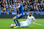 Swansea City defender Ashley Williams slides into tackle Leicester City midfielder Andy King during the Barclays Premier League match between Leicester City and Swansea City at the King Power Stadium, Leicester, England on 24 April 2016. Photo by Alan Franklin.
