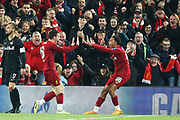 Liverpool defender Andrew Robertson (26) celebrates his goal 2-0 with Liverpool defender Trent Alexander-Arnold (66) during the Champions League match between Liverpool and FC Red Bull at Anfield, Liverpool, England on 2 October 2019.