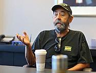 Jay Kaiser, of Cedar Rapids, talks with a reporter at Wells Fargo Bank in Cedar Rapids on Tuesday, July 16, 2013.
