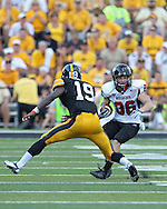 August 31 2013: Northern Illinois Huskies wide receiver Jacob Brinlee (86) tries to avoid Iowa Hawkeyes defensive back B.J. Lowery (19) during the second half of the NCAA football game between the Northern Illinois Huskies and the Iowa Hawkeyes at Kinnick Stadium in Iowa City, Iowa on August 31, 2013. Northern Illinois defeated Iowa 30-27.