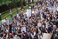 """Black Lives Matter""  Over a thousand people marched through London chanting ""hands up don't shoot"".  The black community was outraged by US police brutality after killing of two black men - one in Minnesota and one in Louisiana."