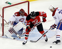 Jan 22, 2010; Newark, NJ, USA; New Jersey Devils right wing Nick Palmieri (16) screens Montreal Canadiens goalie Jaroslav Halak (41) during the first period at the Prudential Center.