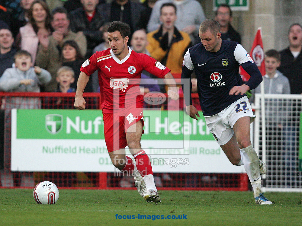Picture by Paul Terry/Focus Images Ltd. 07545642257.19/11/11.Matt Tubbs of Crawley and Harry Worley of Oxford during the Npower League 2 match at Broadwood stadium, Crawley, West Sussex.
