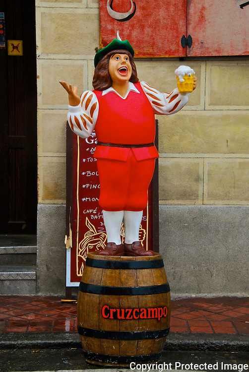 Cruzcampo beer man on barrel in front of restaurant in Spain.