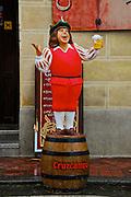 Cruzcampo beer man on barrel in front of restaurant in Spain.