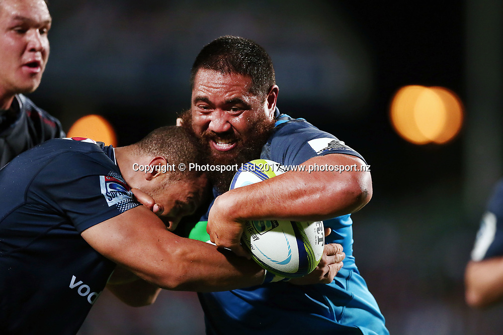 Charlie Faumuina of the Blues fends against Travis Ismaiel of the Bulls. Super Rugby match, Blues v Bulls at QBE Stadium, Auckland, New Zealand. 25 March 2017 © Copyright Photo: Anthony Au-Yeung / www.photosport.nz