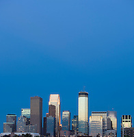 Dramatic view of the Minneapolis skyline at dusk from West looking East.