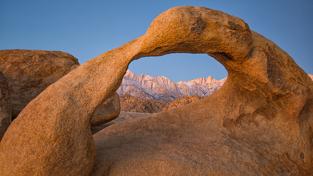 Pre-dawn glow,at the Mobius arch - Alabama Hills, California. Far away, is Mt.Whitney. Pretty rewarding very short walk takes you here. This particular structure is no too big, may be 30 feet wide.
