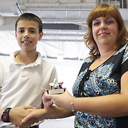 Anthony Caropolo accepts an award from Star News Editor Sherry Jones for the 15 Under 15 project Sunday September 14, 2014 at Jungle Rapids in Wilmington, N.C. (Jason A. Frizzelle)