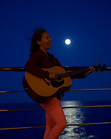 Julie Alone With the Moon on the Baltic Sea. Image taken with a Nikon Df camera and 70-200 mm f/4 VR lens (ISO 1600, 70 mm, f/4, 1/125 sec). Raw image processed with Capture One Pro, Nik Define, and Photoshop CC.