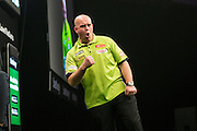 Michael van Gerwen celebrates winning a leg during the Premier League Darts  at the Motorpoint Arena, Cardiff, Wales on 31 March 2016. Photo by Shane Healey.