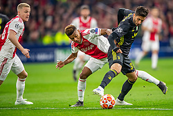 10-04-2019 NED: Champions League AFC Ajax - Juventus,  Amsterdam<br /> Round of 8, 1st leg / Ajax plays the first match 1-1 against Juventus during the UEFA Champions League first leg quarter-final football match / Rodrigo Bentancur #30 of Juventus, David Neres #7 of Ajax