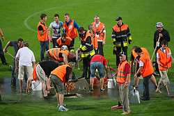 ALTACH, AUSTRIA - Saturday, July 17, 2010: Workers frantically try and remove water from the pitch before Liverpool's first preseason match of the 2010/2011 season at the Cashpoint Arena. (Pic by David Rawcliffe/Propaganda)