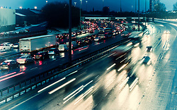 Night view of traffic on M8 Motorway during bad weather in central Glasgow, Scotland, United Kingdom.