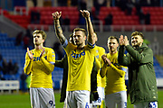 Liam Cooper (6) of Leeds United celebrates in front of the Leeds United fans at full time after a 3-0 win during the EFL Sky Bet Championship match between Reading and Leeds United at the Madejski Stadium, Reading, England on 12 March 2019.