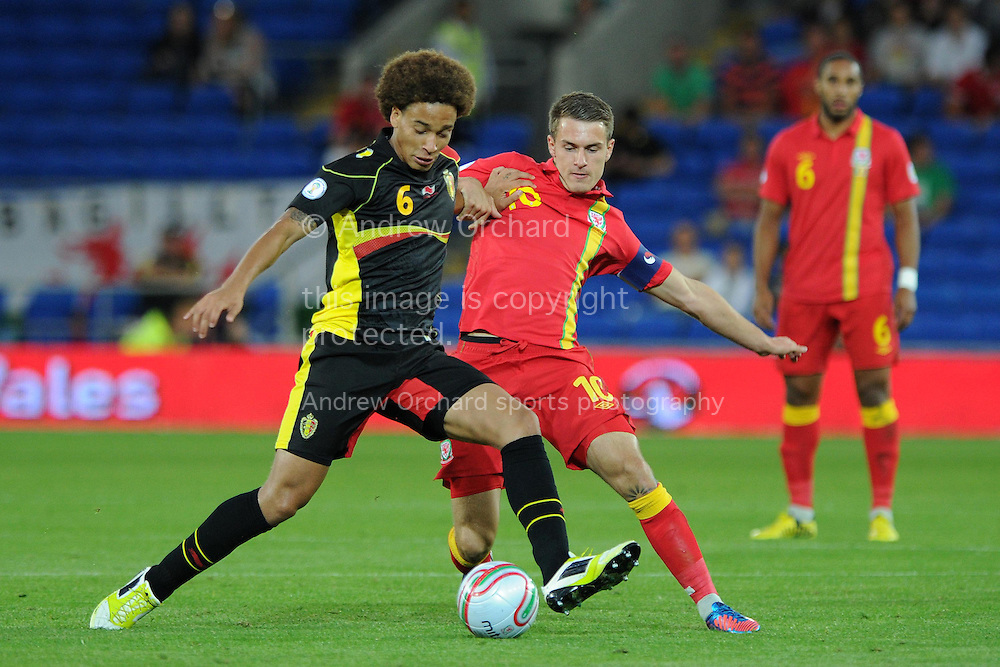 Axel Witsel of Belgium holds off Aaron Ramsey of Wales ®. World cup 2014 qualifying match, Group A, Wales v Belgium at the Cardiff city stadium in Cardiff, South Wales on Friday 7th Sept 2012.  pic by  Andrew Orchard, Andrew Orchard sports photography,