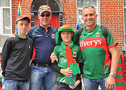 Cian and Sean Mulchrone from Westport with Peadar and Gus O'Toole from Inisturk on their way to the All Ireland Semi-final between Mayo and Dublin on sunday last.<br /> Pic Conor McKeown