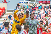 Jon McLaughlin (#1) of Sunderland AFC grabs the ball ahead of Christian Burgess (#6) of Portsmouth FC during the EFL Sky Bet League 1 match between Sunderland and Portsmouth at the Stadium Of Light, Sunderland, England on 17 August 2019.