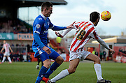 Jed Wallace closes down Raffaele De Vita during the Sky Bet League 2 match between Cheltenham Town and Portsmouth at Whaddon Road, Cheltenham, England on 20 December 2014. Photo by Alan Franklin.