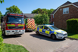 © Licensed to London News Pictures. 06/05/2020. Woolton Hill, UK. A fire engine from the Hampshire Fire and Rescue Service and a police car from the Hampshire Constabulary parked on Woolton Lodge Gardens. A fire has destroyed two houses on Woolton Lodge Gardens, Woolton Hill in Hampshire. The fire started approximately 20:10 BST on Tuesday 05/05/2020. Photo credit: Peter Manning/LNP