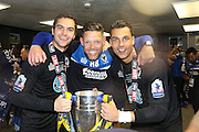 Ashley Bayes, AFC Wimbledon goalkeeper James Shea (1)and AFC Wimbledon goalkeeper Kelle Roos (29) celebrating in the dressing room at Wembley after winning the Sky Bet League 2 play off final match between AFC Wimbledon and Plymouth Argyle at Wembley Stadium, London, England on 30 May 2016.