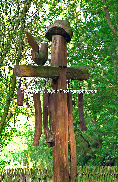 Wooden wind chime artifact in a reconstructed ancient Slavic settlement.  Biskupin Poland