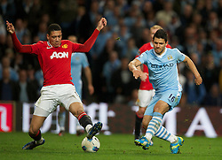MANCHESTER, ENGLAND - Monday, April 30, 2012: Manchester City's Sergio Aguero in action against Manchester United during the Premiership match at the City of Manchester Stadium. (Pic by David Rawcliffe/Propaganda)