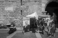 COMO, ITALY - 21 JUNE 2017: Residents of Como gather at a gazebo at Mario Landriscina's rally,  the leading candidate for mayor of Como after the first round of voting to replace the left-leaning mayor, here at the Broletto, a medieval building next to the Cathedral in Como, Italy, on June 21st 2017. Mr Landriscina wants to close the reception centers.<br /> <br /> Residents of Como are worried that funds redirected to migrants deprived the town's handicapped of services and complained that any protest prompted accusations of racism.<br /> <br /> Throughout Italy, run-off mayoral elections on Sunday will be considered bellwethers for upcoming national elections and immigration has again emerged as a burning issue.<br /> <br /> Italy has registered more than 70,000 migrants this year, 27 percent more than it did by this time in 2016, when a record 181,000 migrants arrived. Waves of migrants continue to make the perilous, and often fatal, crossing to southern Italy from Africa, South Asia and the Middle East, seeing Italy as the gateway to Europe.<br /> <br /> While migrants spoke of their appreciation of Italy's humanitarian efforts to save them from the Mediterranean Sea, they also expressed exhaustion with the country's intricate web of permits and papers and European rules that required them to stay in the country that first documented them.