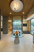 Glass topped table in reception room of California home