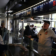 Fast food is prepared for customers inside Yankee Stadium during the New York Yankees V Detroit Tigers Baseball game at Yankee Stadium, The Bronx, New York. 28th April 2012. Photo Tim Clayton