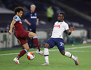 Serge Aurier of Tottenham tackles Felipe Anderson of West Ham United during the Premier League match at the Tottenham Hotspur Stadium, London. Picture date: 23rd June 2020. Picture credit should read: David Klein/Sportimage