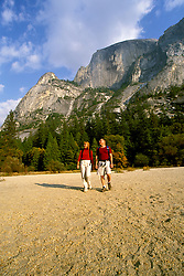 CA: Yosemite National Park, Young couple hiking near Mirror Lake, model released     .Photo Copyright: Lee Foster, lee@fostertravel.com, www.fostertravel.com, (510) 549-2202.cayose212