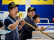 07 JUNE 2018 - SEOUL, SOUTH KOREA:  An auctioneer looks for bids during the wholesale fish auction in the Noryangjin Fish Market. The auctions start about 01.00 AM and last until 05.00 AM. Noryangjin Fish Market is the largest fish market in Seoul and has been in operation since 1927. It opened in the current location in 1971 and was renovated in 2015. The market serves both retail and wholesale customers and has become a tourist attraction in recent years.    PHOTO BY JACK KURTZ