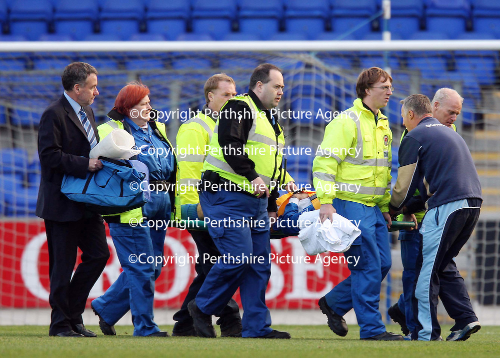 St Johnstone v Queen of the South....20.10.07<br /> Rocco Quinn is stretchered off<br /> Picture by Graeme Hart.<br /> Copyright Perthshire Picture Agency<br /> Tel: 01738 623350  Mobile: 07990 594431
