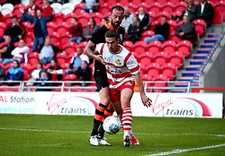 Tommy Rowe of Doncaster Rovers takes on Steven Fletcher of Sheffield Wednesday - Mandatory by-line: Robbie Stephenson/JMP - 26/07/2017 - FOOTBALL - The Keepmoat Stadium - Doncaster, England - Doncaster Rovers v Sheffield Wednesday - Pre-season friendly
