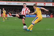 Ryan Jennings and Ryan Lloyd during the Vanarama National League match between Cheltenham Town and Chester City at Whaddon Road, Cheltenham, England on 5 December 2015. Photo by Antony Thompson.