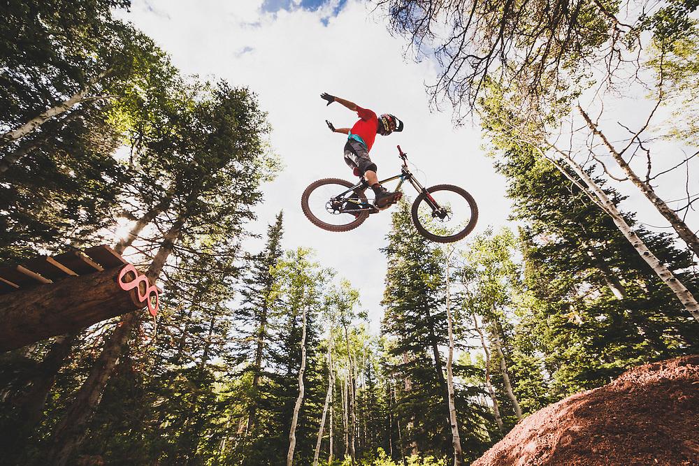 Greg Watts jumping his downhill mountain bike at Canyons Resort.