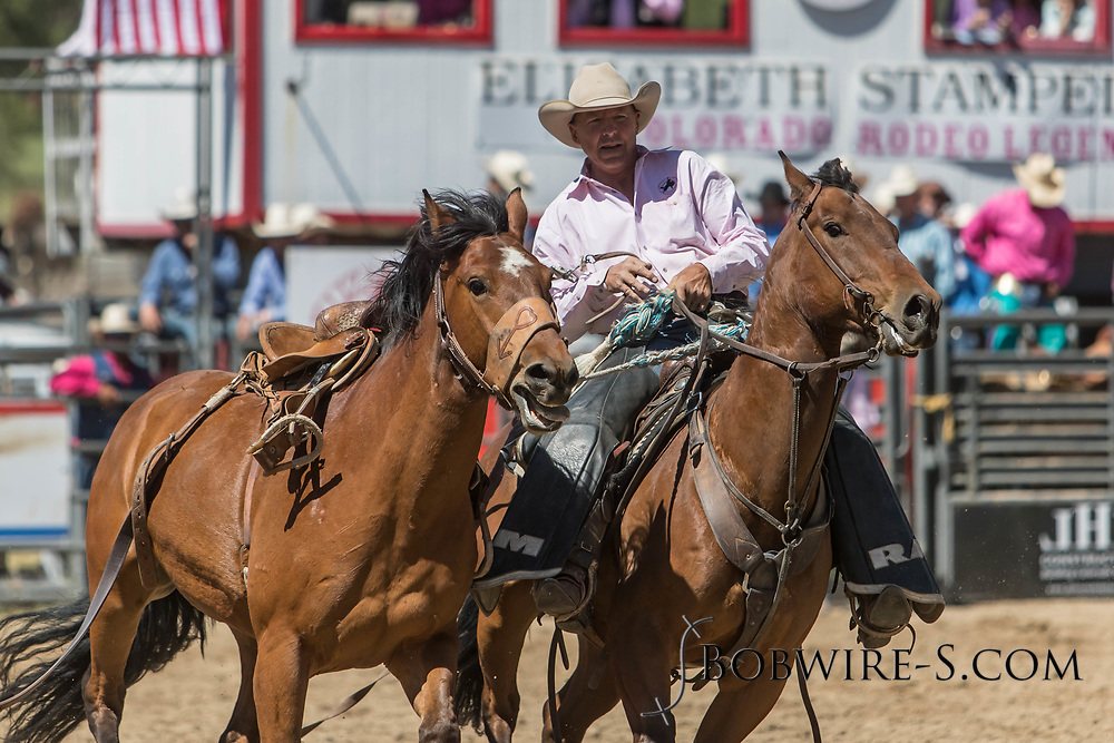 Pickup man Scott McClain gets control of a saddle bronc in the first performance of the Elizabeth Stampede on Saturday, June 2, 2018.