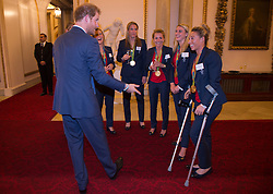 October 18, 2016 - London, United Kingdom - UK OUT Image licensed to i-Images Picture Agency. 18/10/2016. London, United Kingdom. Prince Harry talks to the Ladies Hockey team including Susannah Townsend on crutches, at a reception for Team GB and ParalympicsGB medallists from the 2016 Olympic and Paralympic Games at Buckingham Palace in London. Picture by ROTA / i-Images  UK OUT (Credit Image: © Rota/i-Images via ZUMA Wire)