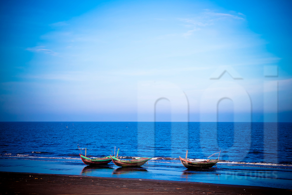 Boats are moored along the beach. seascape in nam dinh province