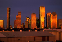Western side of the Houston, Texas skyline reflecting the setting sun.
