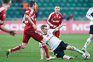 (R) Legia's Ondrej Duda fights for the ball during T-Mobile ExtraLeague soccer match between Legia Warsaw and Wisla Krakow in Warsaw, Poland.<br /> <br /> Poland, Warsaw, March 15, 2015<br /> <br /> Picture also available in RAW (NEF) or TIFF format on special request.<br /> <br /> For editorial use only. Any commercial or promotional use requires permission.<br /> <br /> Mandatory credit:<br /> Photo by © Adam Nurkiewicz / Mediasport