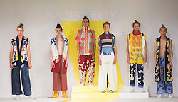 © Licensed to London News Pictures. 01/06/2015. London, UK. Collection by Nadia Kelly. Fashion show of De Montfort University (Leicester) at Graduate Fashion Week 2015. Graduate Fashion Week takes place from 30 May to 2 June 2015 at the Old Truman Brewery, Brick Lane. Photo credit : Bettina Strenske/LNP