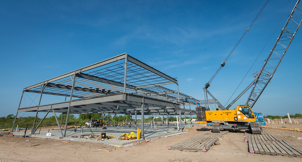 Construction crews work on the new South Early College High School, August 11, 2015.