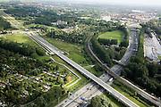Nederland, Zuid-Holland, Rotterdam , 08-09-2006;  ; .HSL loop - diagonaal van rechtsonder naar linksboven - en verdwijnt in de tunnel Noordrand Rotterdam, de reguliere spoorlijn buigt af, richting Gouda; autosnelweg A20 gaat onder beide sporen door; infrastructuurbundel, transport, infrastructuur, verkeer en vervoer, mobiliteit, hogesnelheidslijn, spoor, rail, HSL, TGV, planologie, ruimtelijke ordening, landschap; .zie ook detailfoto en panorama foto van deze lokatie; deel van de serie Panorama Nederland.luchtfoto (toeslag); aerial photo (additional fee required); .foto Siebe Swart / photo Siebe Swart
