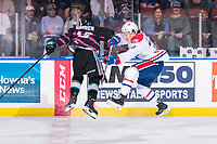 KELOWNA, BC - SEPTEMBER 21:  Michael Farren #16 of the Kelowna Rockets checks Adam Beckman #34 of the Spokane Chiefs during overtime at Prospera Place on September 21, 2019 in Kelowna, Canada. (Photo by Marissa Baecker/Shoot the Breeze)