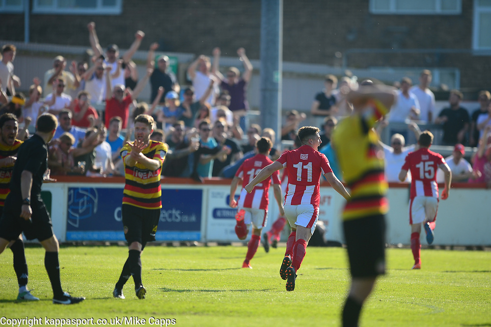 BRACKLEY AARON WILLIAMS RUNS AWAY TO CELEBRATE HIS WINNING GOAL WHILE BRADFORD PROTEST TO REFEREE IT WAS PUT IN WITH HIS HAND, Brackley Town v Bradford Park Avenue Vanarama National League North Play Off Semi Final, St James Park Sunday 6th May 2018, Score Brackley 1-0 (Williams) AET.