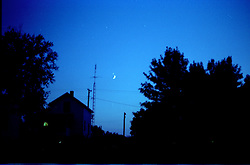 Venus or Jupiter sits just above a present moon viewed from Heyworth Illinois - 1980 or 1981.<br /> <br /> This image was scanned from a slide, print or transparency.  Image quality may vary.  Dust and other unwanted artifacts may exist.